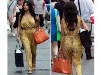 Kourtney_Kardashian in jumpsuit with orange bag